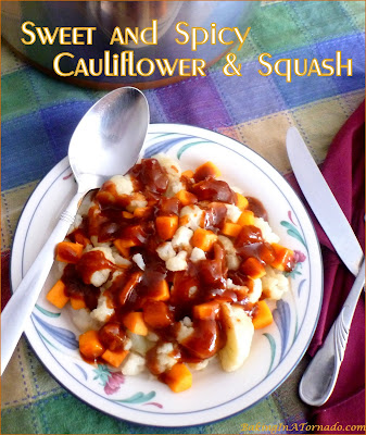 Sweet and Spicy Cauliflower and Squash marries vegetables with onion and apple studded barbecue sauce. Serve as a side dish or add leftover pork and rice for a full dinner. | Recipe developed by www.BakingInATornado.com | #recipe #vegetables