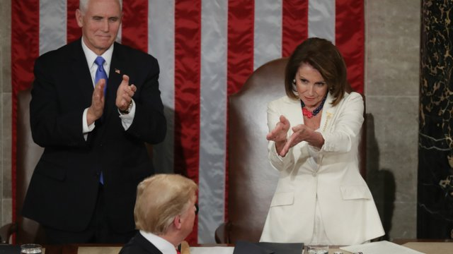 House Speaker Nancy Pelosi and VP Pence applaud Trump in one of the moments of the speech