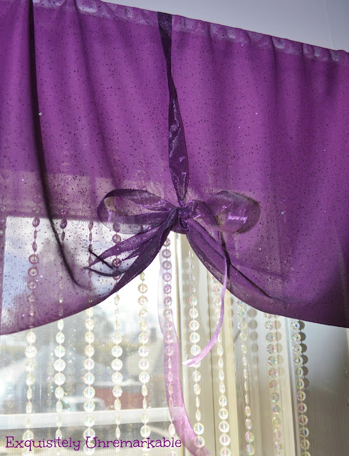 Easy Ribbon Valance in purple sheer fabric over beads on window