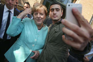His selfie with Angela Merkel went viral for all the wrong reasons. Now this refugee is suing Facebook.