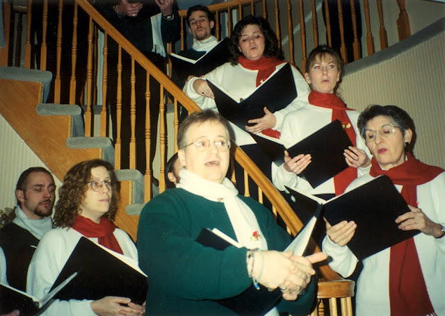 Stairwell Carollers carol in a cozy Stairwell