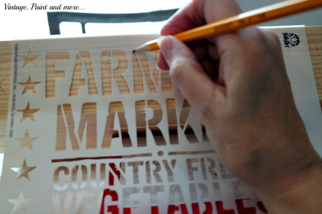 Stencil used on rustic pallet tray from Folkart