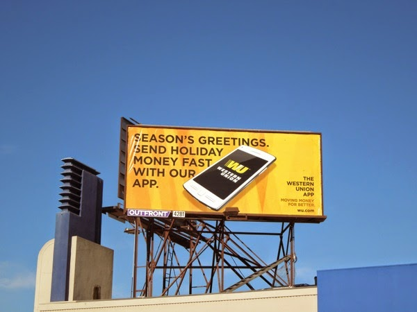 Western Union holiday money app billboard
