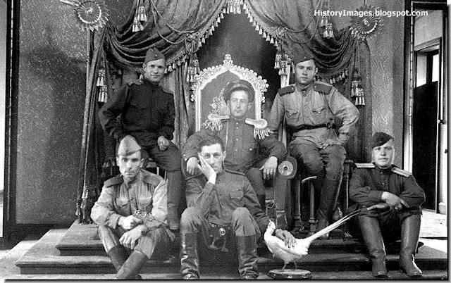 Soviet soldiers sit on the throne of the Last Chinese Emperor, Puyi. September 1945