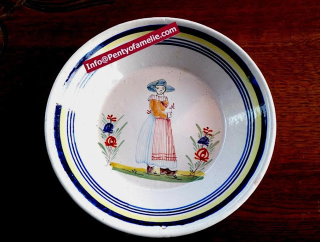 original and unique old Malicorne pottery made in France. late 1800s faience plates depicting breton Woman with floral pattern related to Pouplard Beatrix model.