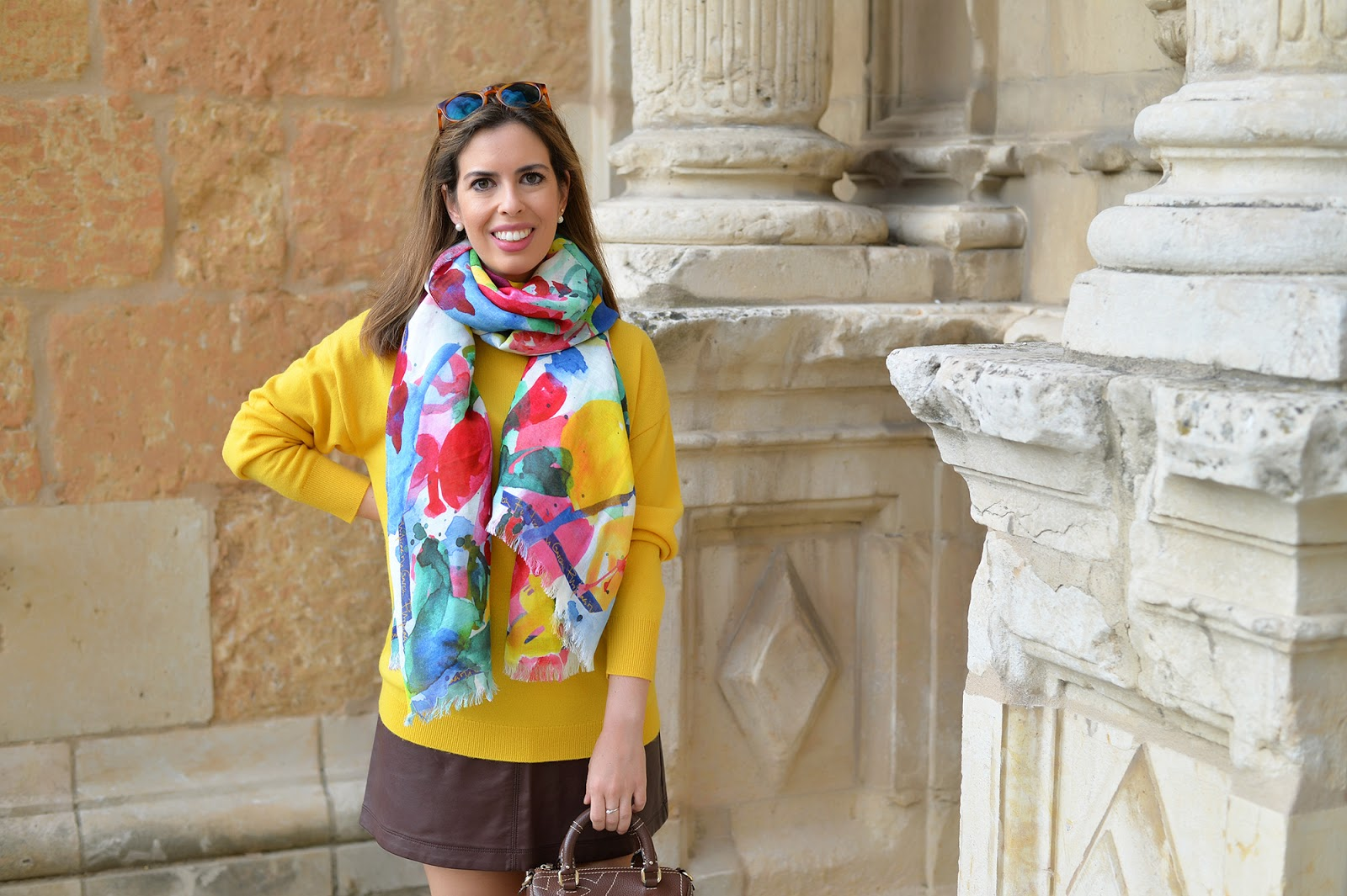 autumn fall travel outfit marigold oversized sweater colorful scarf faux leather skirt