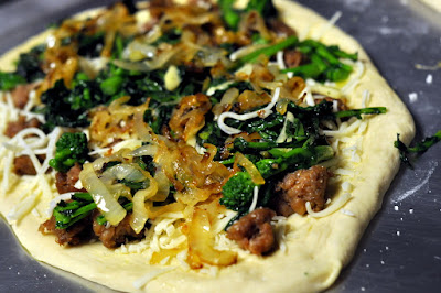 White Pizza with Spicy Italian Sausage, Broccoli Rabe, and Caramelized Onions | Taste As You Go