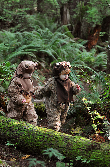 two cute children dressed as ewoks from jedi