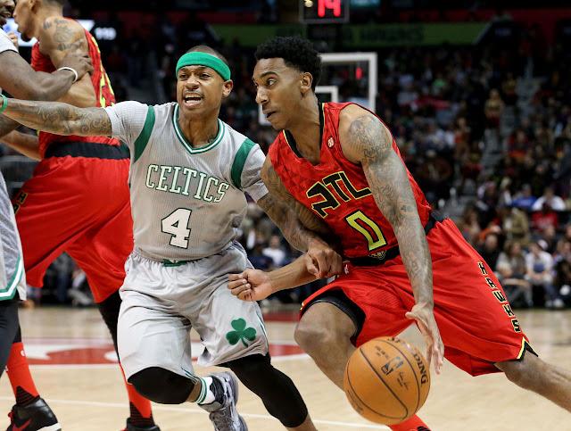 Jeff Teague (Atlanta Hawks) et Isaiah Thomas (Boston Celtics) lors d'un match NBA.
