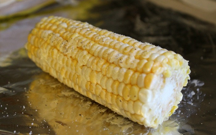 seasoned and buttered corn on the cob for grilling