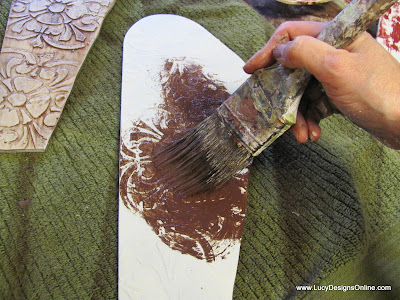 using brown paint wash to enhance texture