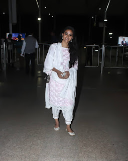 Mana Keerthy Suresh: Keerthy Suresh in White Dress with Cute Smile Captured at Hyderabad Airport