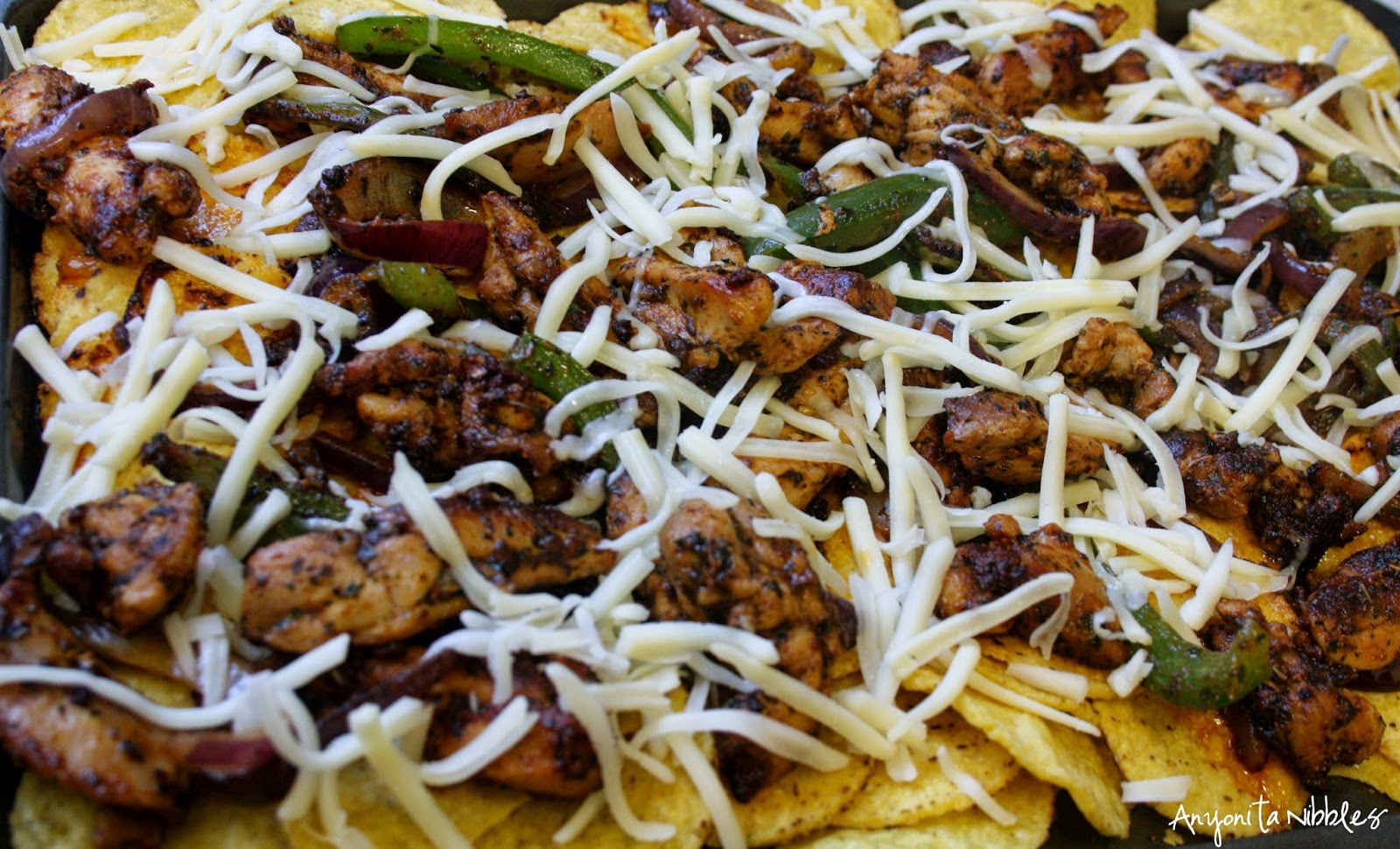Baking the nachos gives them a crisper texture and a deeper flavor