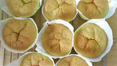 pandan chiffon cupcakes cooling down, tops no longer cracked