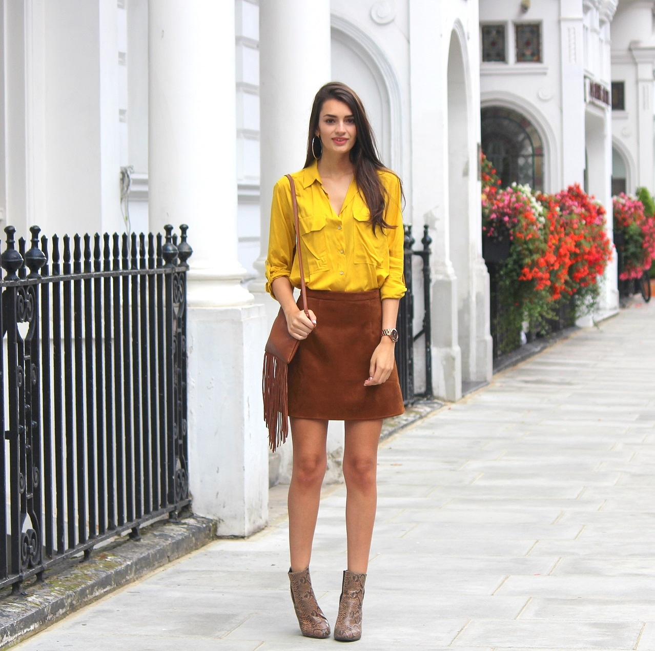 peexo fashion blogger wearing mustard shirt and suede skirt and snake print ankle boots