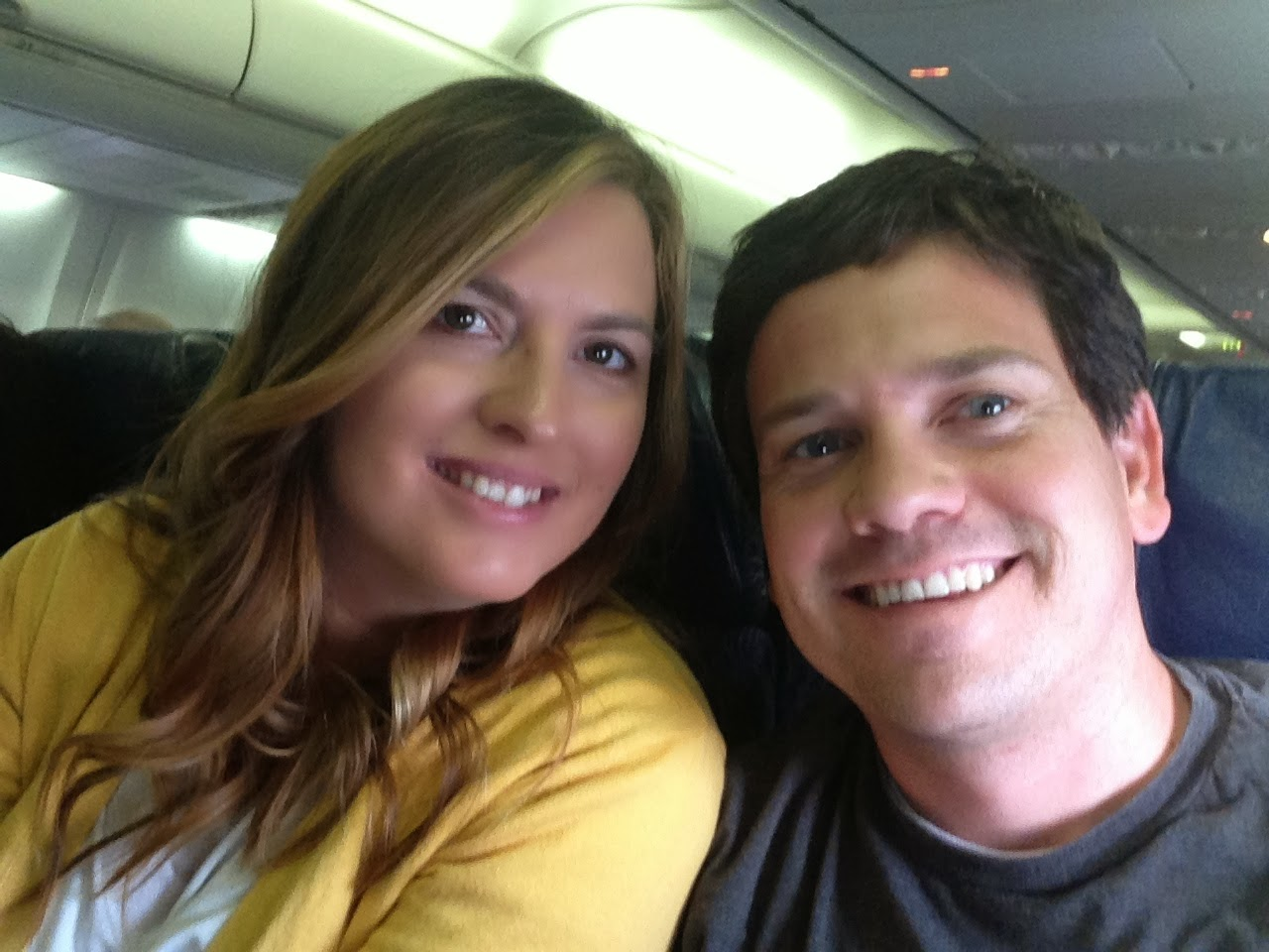 airplane cabin, couple smiling