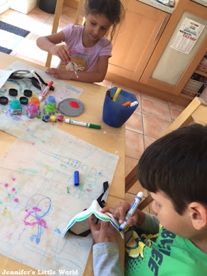 Children painting at the kitchen table