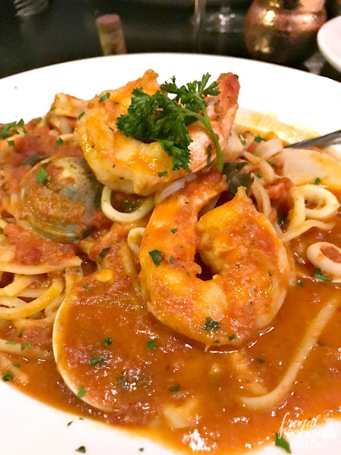 The Seafood Cioppino Style from Il Forno a Legna in McAllen, Texas is a gorgeous stew brimming with chunks of tender fish, mussels, clams, shrimp, & calamari in a flavorful tomato based broth.