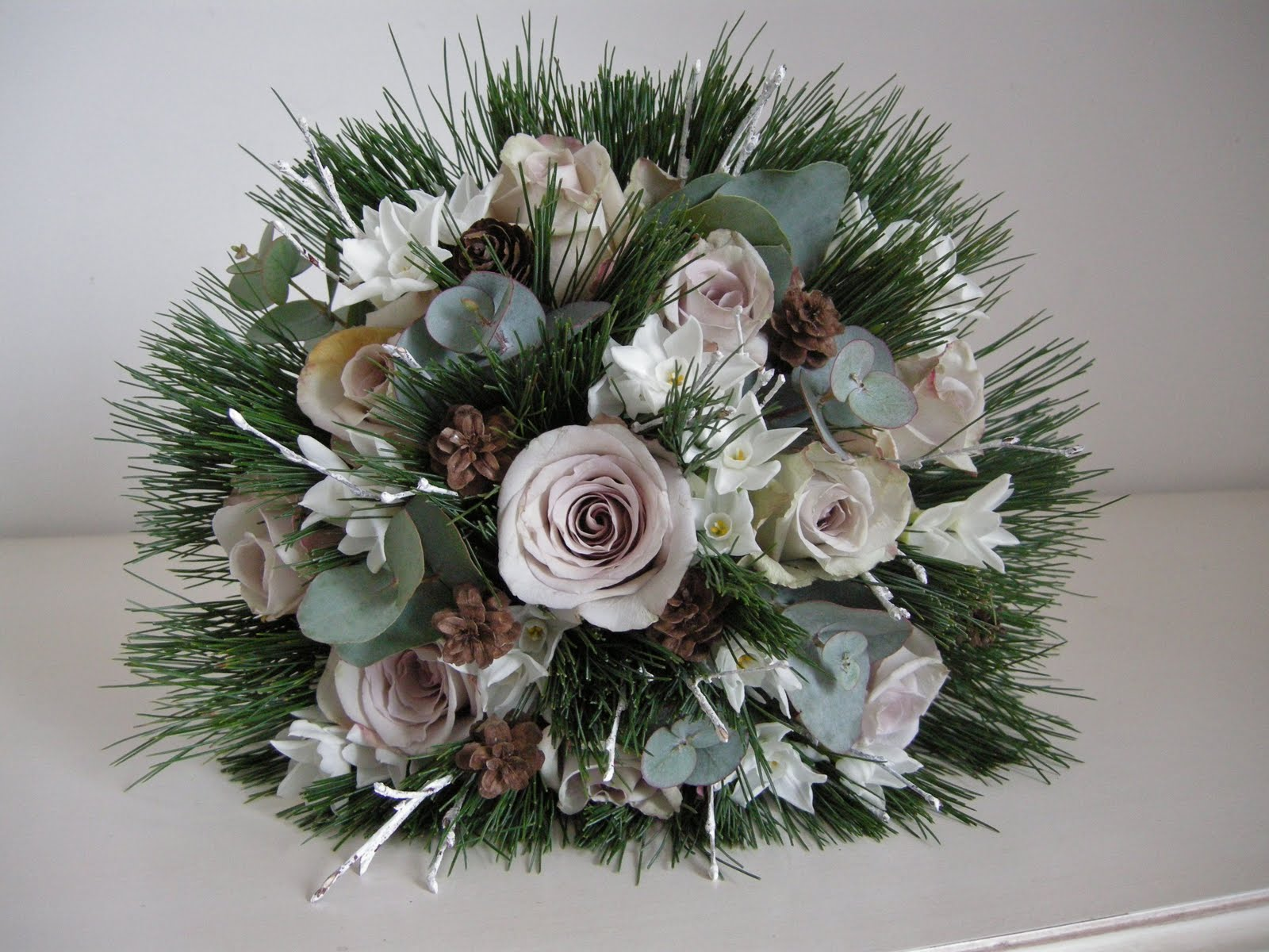 Winter Wedding Bouquet Of Lilac Roses Pine Mini Cones Paperwhites For Perfume Eucalyptus And Some Gently Glittered Twigs To Catch The Light