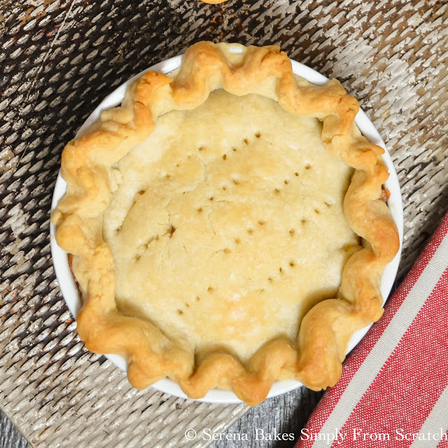Chicken Pot Pie is loaded with carrots, peas and chicken in a creamy gravy then covered with a flaky pie crust.