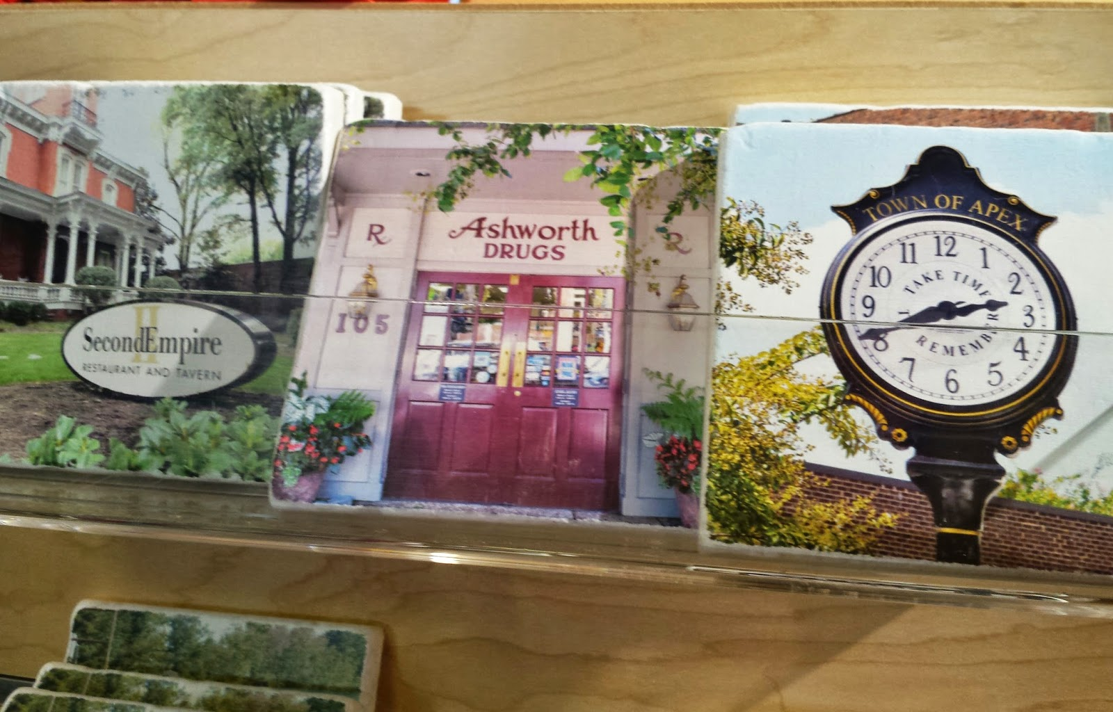 Picturesque coasters of RDU scenes at Whisk Carolina in Waverly Place