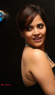 Telugu Anchor Actress Anasuya Bharadwa Stills in Strap Less Black Long Dress at Winner Pre Release Function  0030.jpg