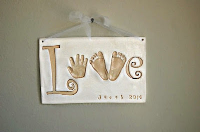 https://www.etsy.com/listing/208841898/baby-handprint-and-footprints-spelling?ref=favs_view_5