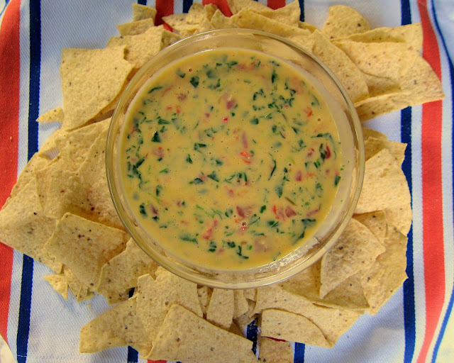Easy Spinach Queso - only 3 ingredients! I love this stuff! Tastes just like the queso at J. Alexander's. I could make a meal out of this dip!