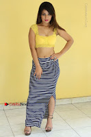 Cute Telugu Actress Shunaya Solanki High Definition Spicy Pos in Yellow Top and Skirt  0140.JPG