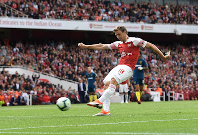Nacho Monreal kicking the ball