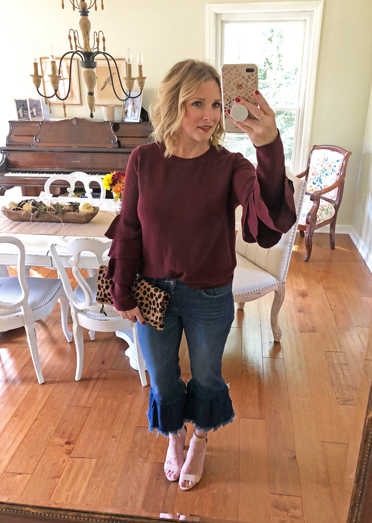 ruffle sweater with ruffle jeans and heels