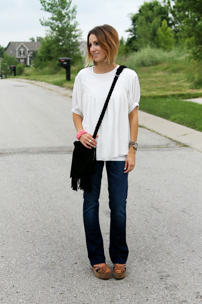 Loose, boho blouse, boot cut denim, and black fringe bag