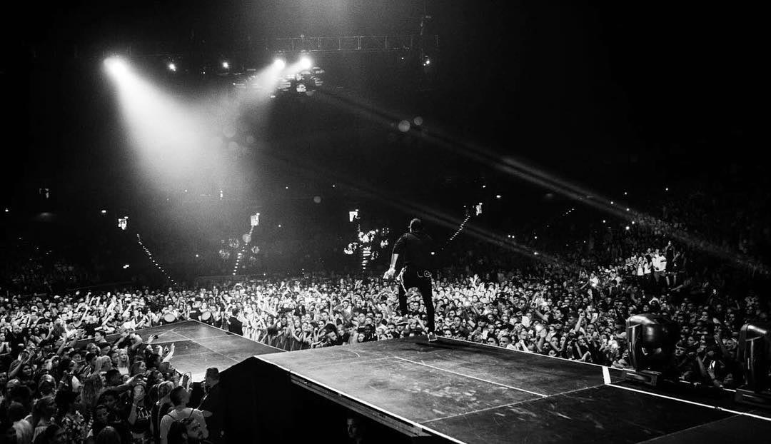 Wizkid performs on stage as he tours Germany with Chris Brown