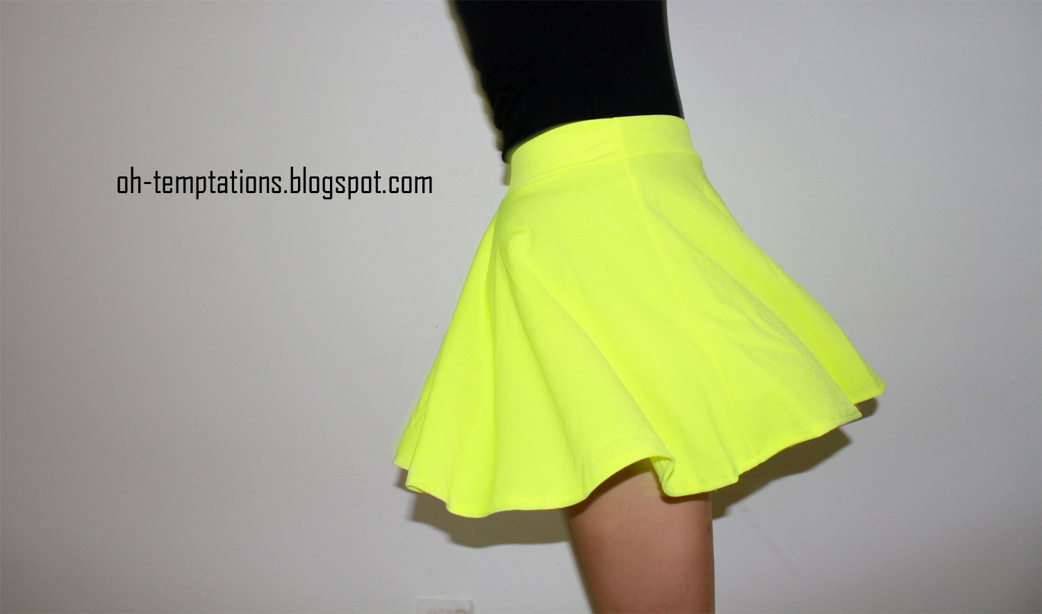 Glow sticks are optional when you've got a blazing bright delight like the Rave Review Yellow Floral Print Skirt! Scuba knit skater skirt embraces all your neon dreams, with the brightest lemon yellow backdrop abloom with fluorescent pink and purple flowers.