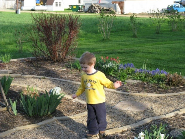 William playing in the garden