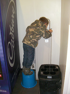 camouflage soldier and drinking fountain