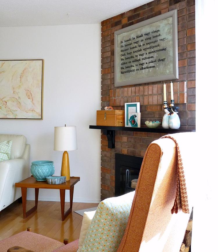 Brick fireplace with art