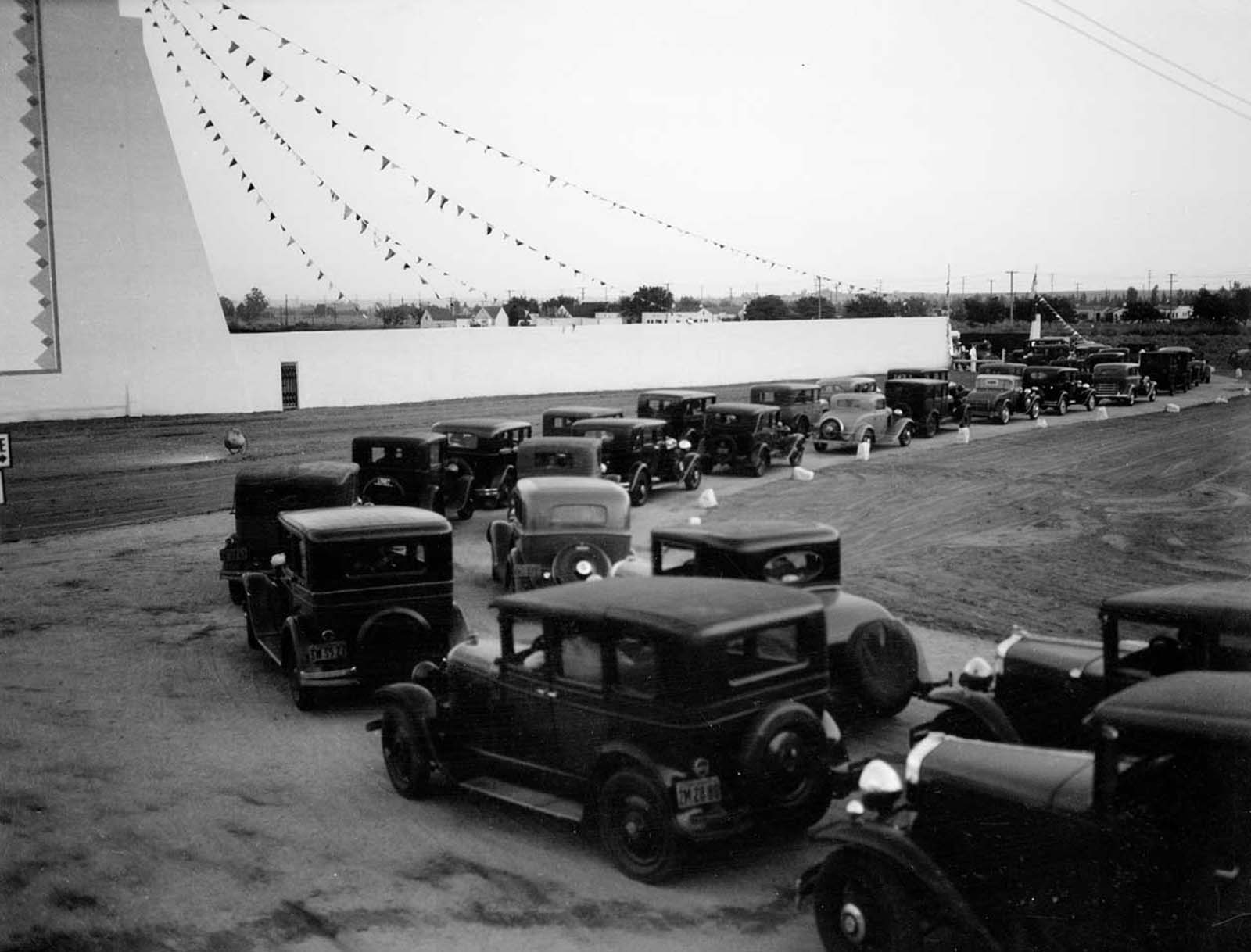 Line of automobiles at opening day of Drive-In Movie Theater.