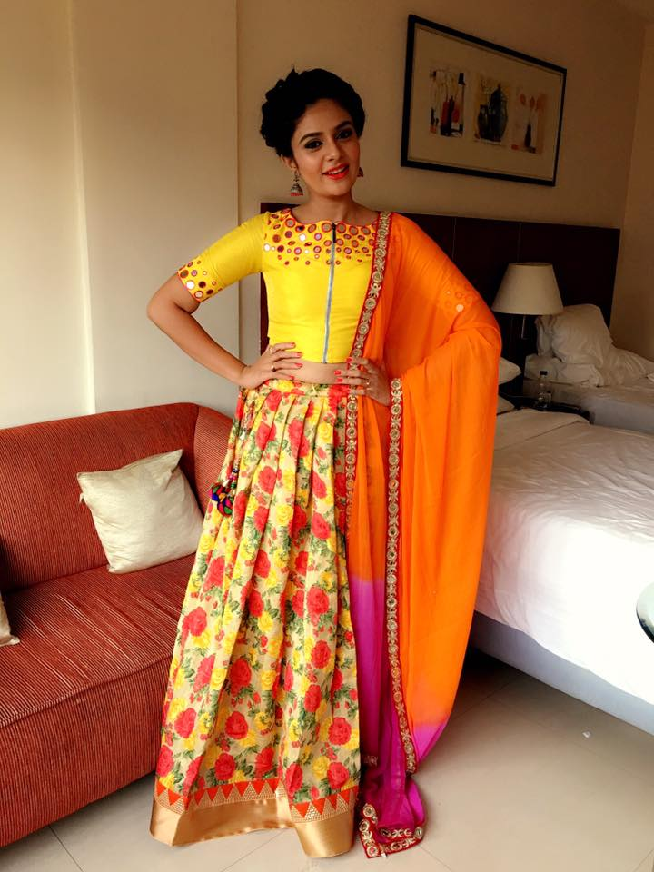 Telugu Tv anchor Sreemukhi In Orange Lehenga Choli