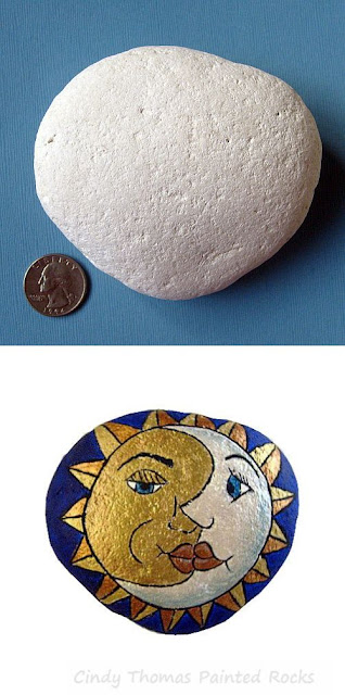 Moon and Sun Faces painted on a stone by Cindy Thomas