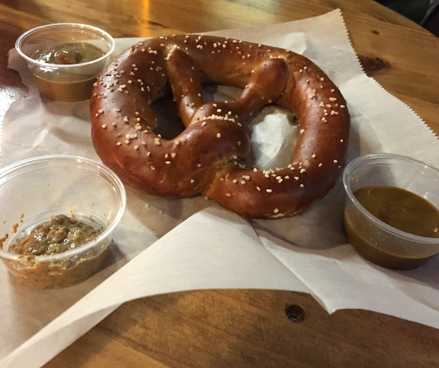 Pretzel and a sampling of Sprecher mustard at Sprecher Brewery