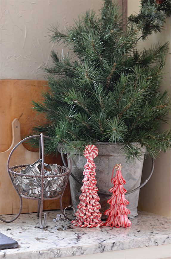 A simple tree in a galvanized bucket makes a perfect kitchen display for Christmas | www.andersonandgrant.com
