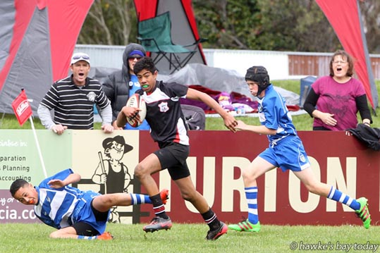 With ball: Kingshouse Tauplua, captain, Napier - Napier beat Hastings West 21-5, Ross Shield, Rugby Park, Dannevirke. photograph