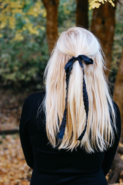 CityFashionGirl (Brianna de Gaston) wearing a big black bow in her blonde hair with the scenic autumn trees in Utah before she moves to Singapore