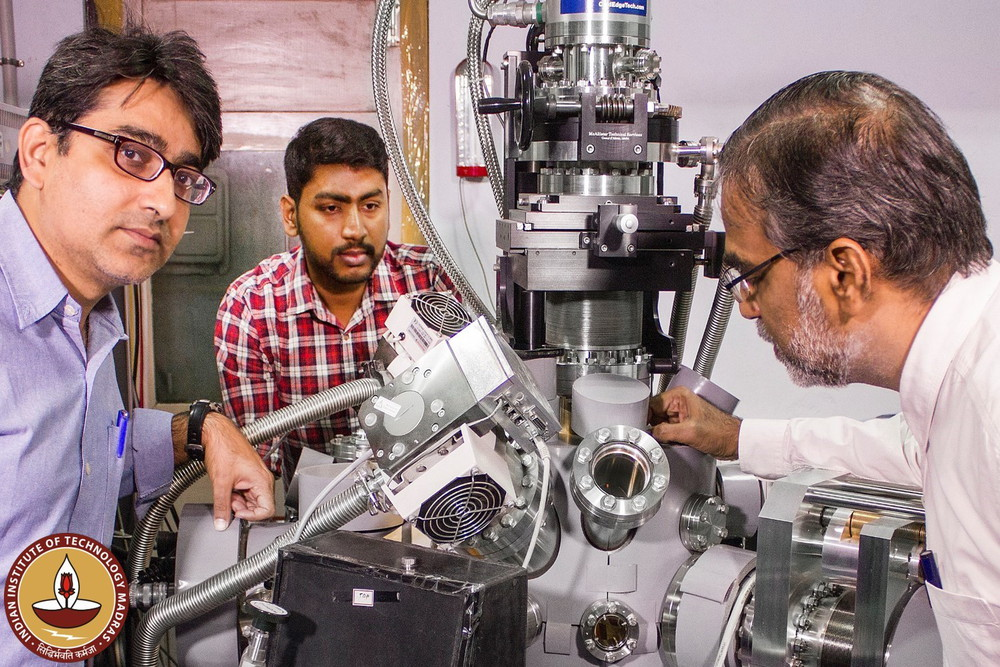 (L_R) Prof. Rajnish Kumar, Jyotirmoy Ghosh and Prof. T. Pradeep around the ultrahigh vacuum chamber