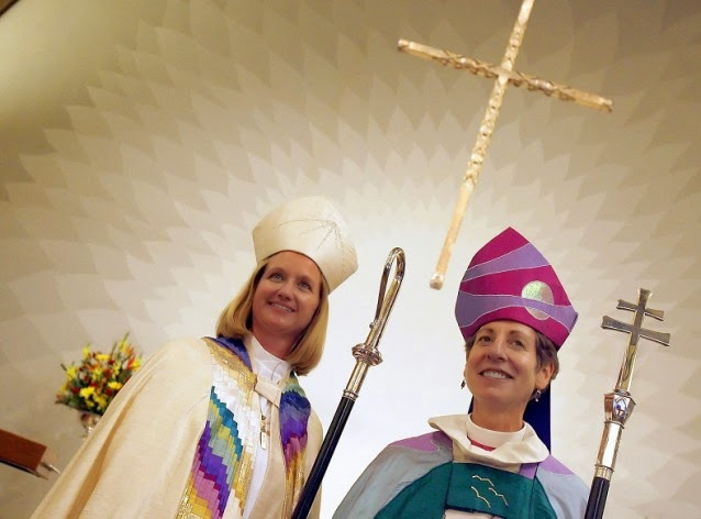Presiding Bishop of The Episcopal Church, the Most Rev. Katharine Jefferts Schori, right, told The Guardian that denying climate change is akin to turning one's back on God's gift of knowledge. (Credit: AP Photo/ Tony Avelar) Click to Enlarge.