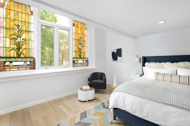 Stained glass windows in modern bedroom in Church conversion to chic private home Chicago
