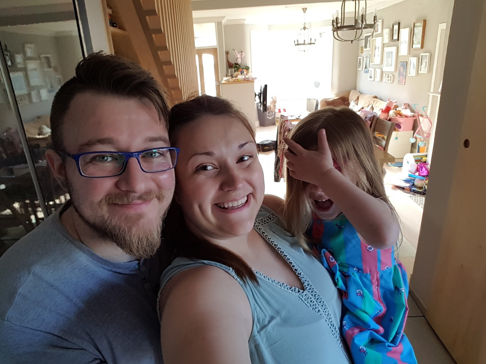 mum dad and daughter in a family selfie