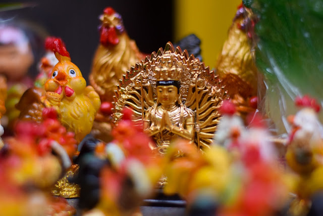Deity and rooster figurines