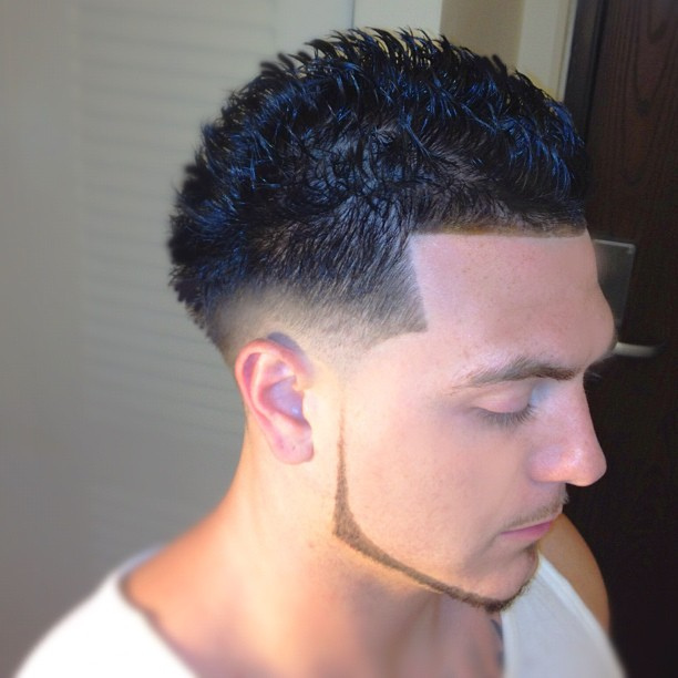 Textured spikes with trimmed beard mens haircuts